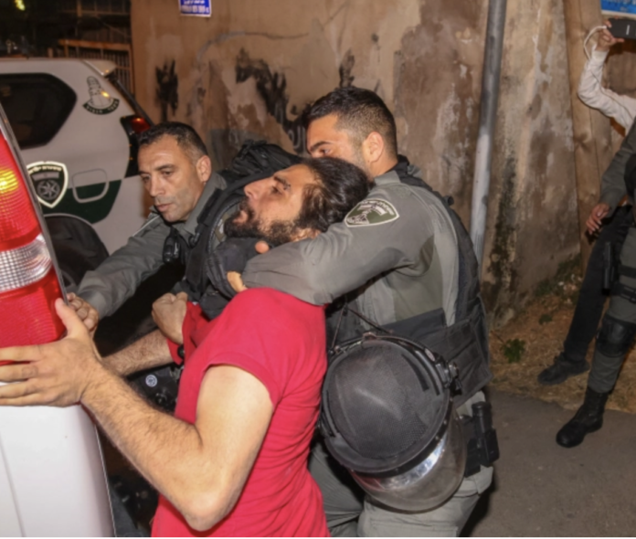 Israeli security forces detain a Palestinian during a confrontation as Palestinian families face eviction in the Sheikh Jarrah neighbourhood of occupied East Jerusalem