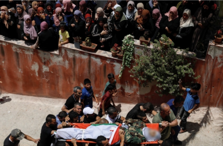Mourners carry the body of Tayseer Issa, who was killed by Israeli forces, during his funeral in Jenin [